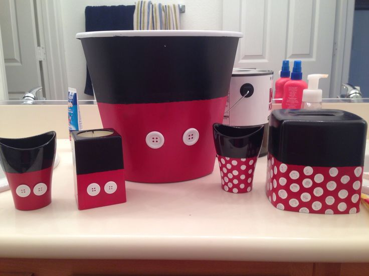 I couldn't find Minnie and Mickey Mouse bathroom accessories so I created my own after seeing a picture online.  They were really easy the hardest part was free handing some of the straight lines because the tape kept peeling the paint off.