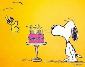 Snoopy with birthday cake via www.Facebook.com/Snoopy