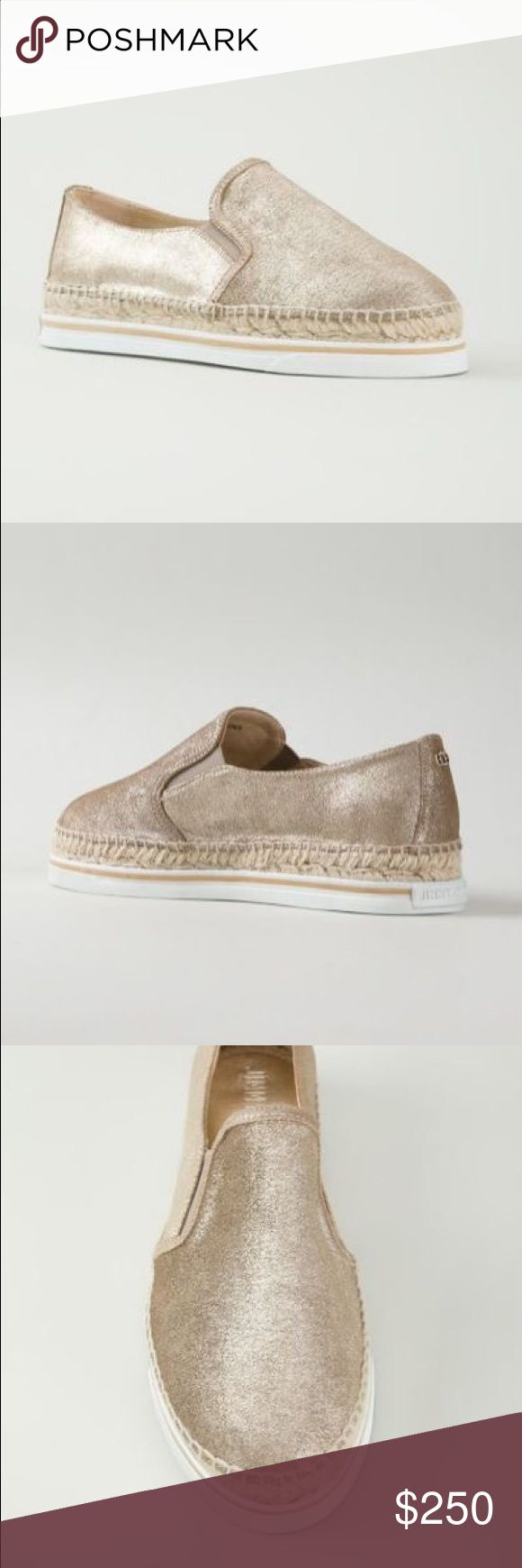 """Jimmy Choo Dawn Metallic Gold Espadrille Sneaker Jimmy Choo metallic embossed suede espadrille-style skate sneaker. 1"""" flat heel. Round toe. Stretch insets at notched vamp. Braided-jute midsole. Rubber outsole. Slip-on style. """"Dawn"""" is made in Italy. Jimmy Choo Shoes Espadrilles"""