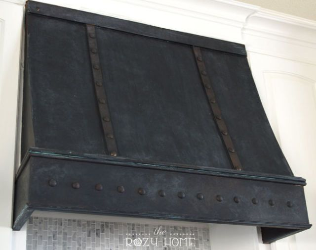 Range hoods don't run cheap, so Jill Rose knew she could get gourmet kitchen style without breaking the bank. To create a realistic bronze patina, she used metallic paint and studded the hood with craft store tacks. See more at The Rozy Home »   - HouseBeautiful.com