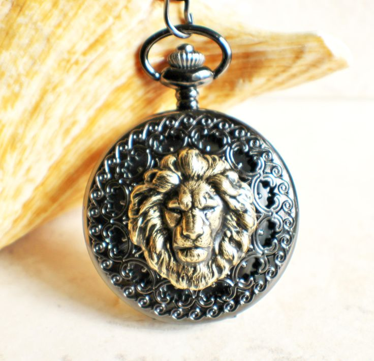 Lion pocket watch, mechanical pocket watch with black spiderweb case. Mounted on front case of pocket watch is a detailed bronze lion. Lion has been sealed with clear resin to give a glass like finish