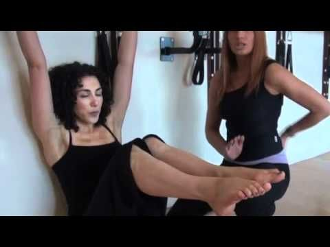 BarreConcept - the hot new barre exercise workout.  Emma Newham of Pilates Union shows you how to do some exercises at home to flatten the abs, lift the butt and sculpt the arms.  Filmed at MyBody Studios, UK.