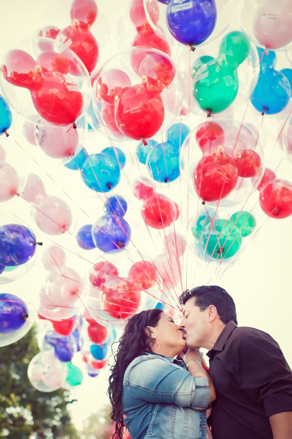 Disneyland engagement pictures. Would love a pic like this!!
