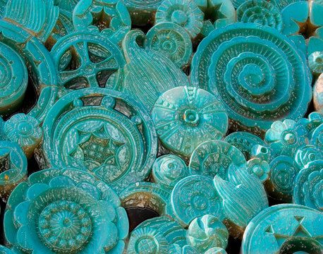 I love the teal glaze on the terra cotta pieces.