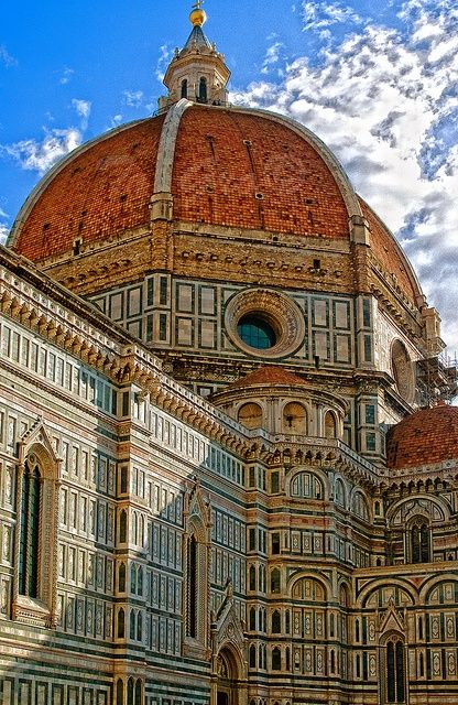 Duomo - florence italy Santa Maria del Fiore and Baptistery. Work on the Gothic cathedral of Santa Maria del Fiore began in 1296 and was completed by Brunelleschi in 1436 with the famous Dome, which was painted inside with frescoes by Vasari and Zuccari.