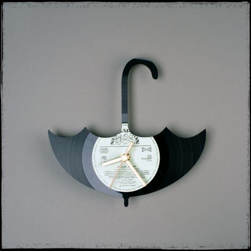 An old vinyl record turned Mary Poppins inspired wall clock... LOVE IT !
