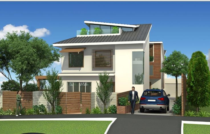 Three unit ESD friendly town homes at construction stage. Extensive use of solar chimneys, trombe walls, greenhouse and reused materials
