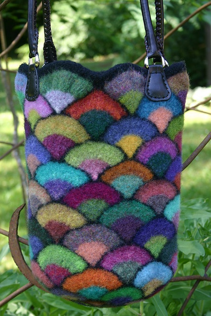 *This is gorgeous. I just bought some Noro yarn recently, and am seeing why there's such a big to-do about it-- It's awesome yarn! Love working with it. Neeeeed more!* Noro felted bucket bag / basket.