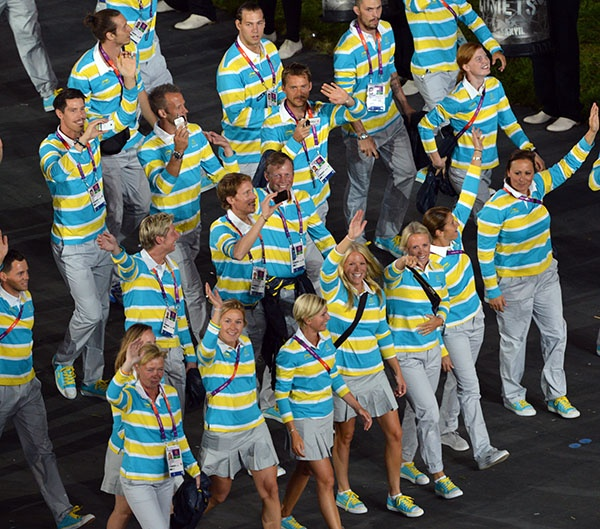 Sweden's delegation parades during the opening ceremony of the London 2012 Olympic Games at the Olympic Stadium in London on July 27, 2012. (Photo by Saeed Khan/AFP/GettyImages)