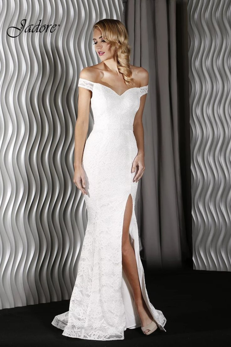 BB1803 -  This Jadore Gown features a sweet heart neckline, off the shoulder sleeves and a large split. Moulded cups and boning provide support. Understated and elegant. Perfect for an informal wedding dress option. Available for purchase or hire