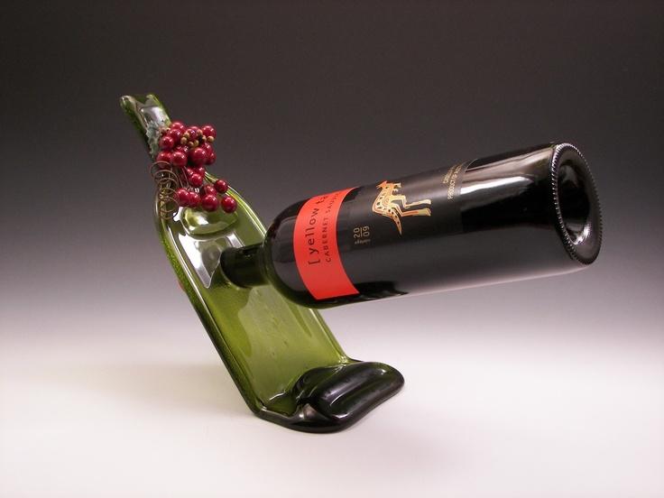 Glass Balancing Wine Bottle Holder/Melted Wine Bottle. $30.00, via Etsy.