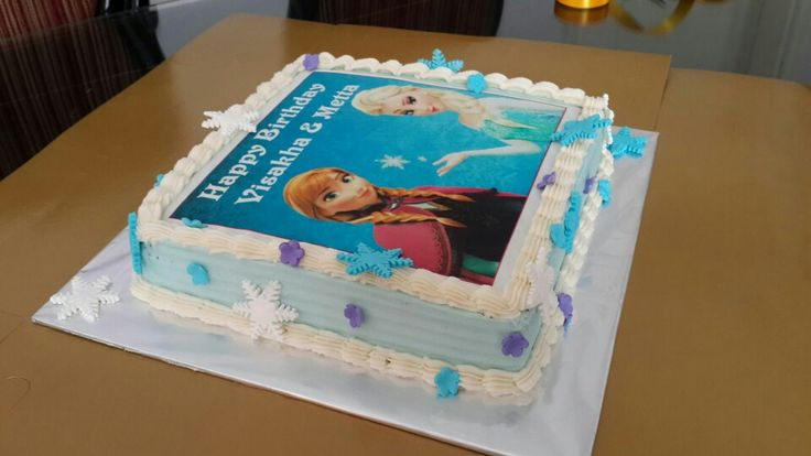 Frozen Theme Celebration Cakes.  Best Selling Eggless Chocolate Cake covered in Blue and White Vanilla Buttercream Frosting, Snowflakes and Flowers.