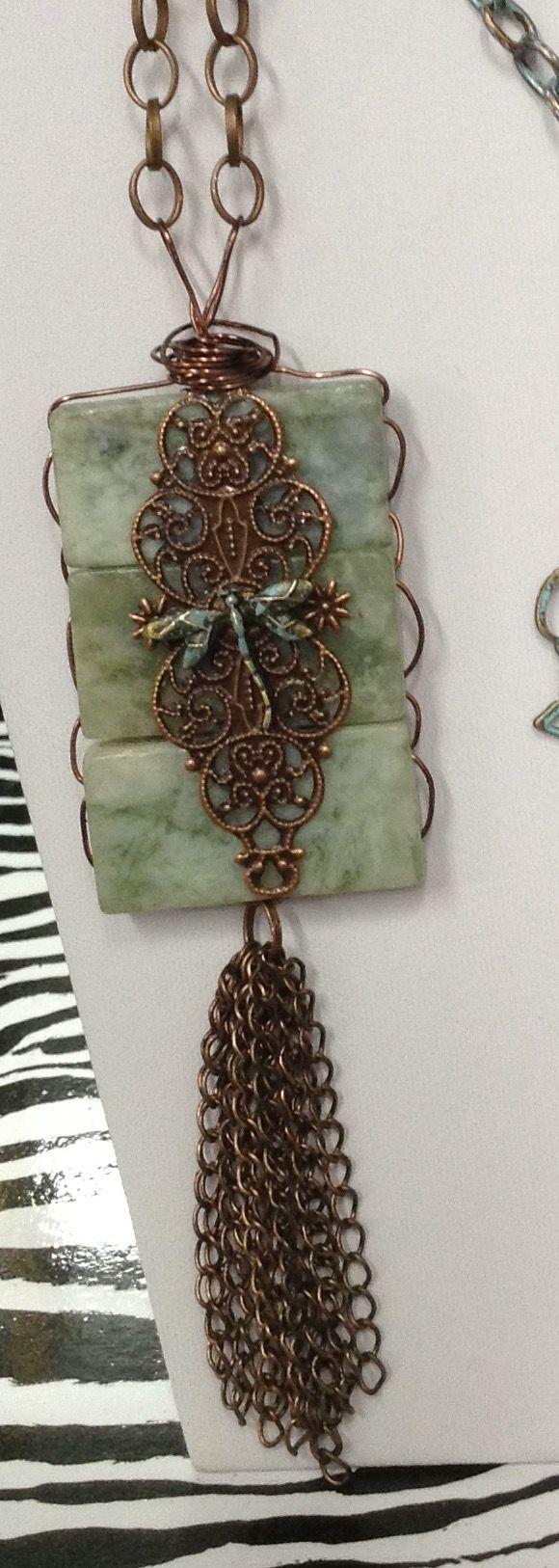 Jade pendant with antique copper embellishments