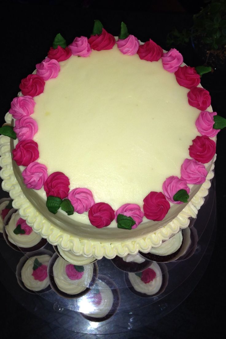 Red velvet cake with cream cheese icing. Decorated with sugar roses