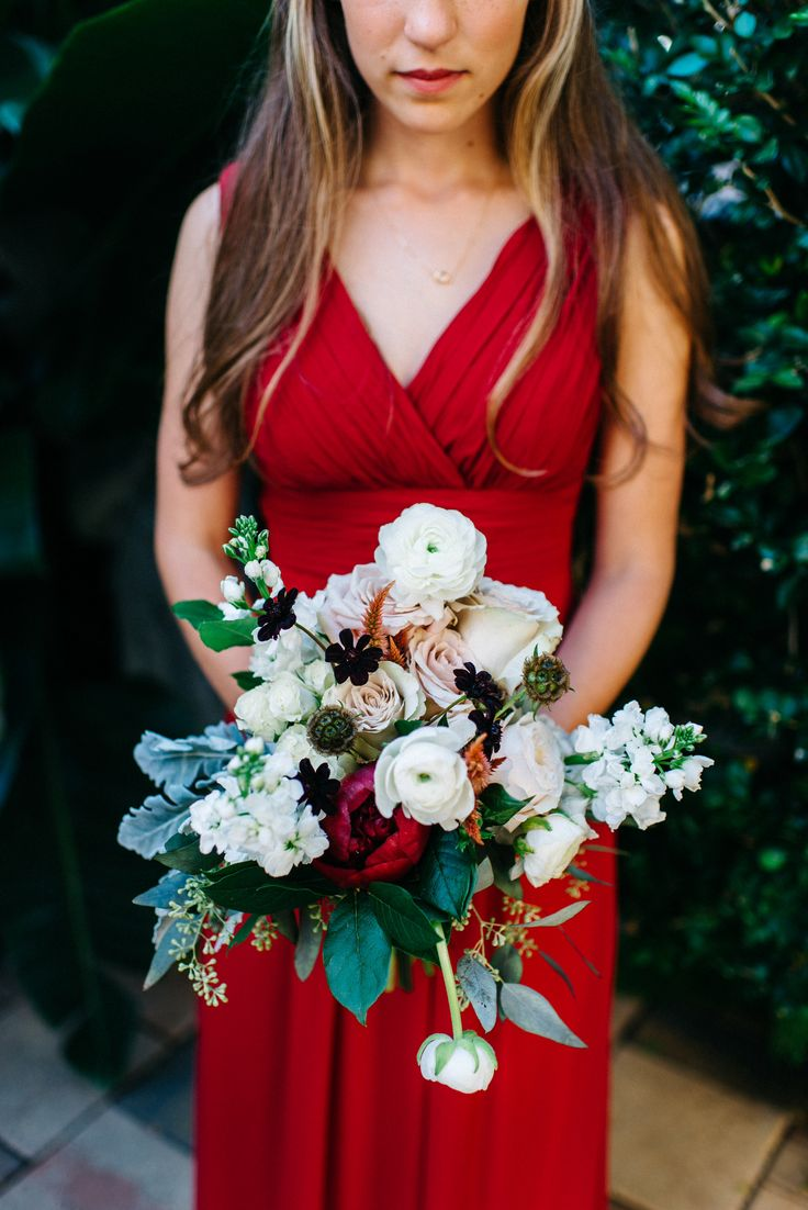 bridesmaid bouquet of red charm peony, white ranunculus, white stock, quicksand rose, Kiera garden rose, chocolate cosmos, white majolica spray rose, scabiosa pods, peach celosia, pink celosia, seeded eucalyptus, dusty miller