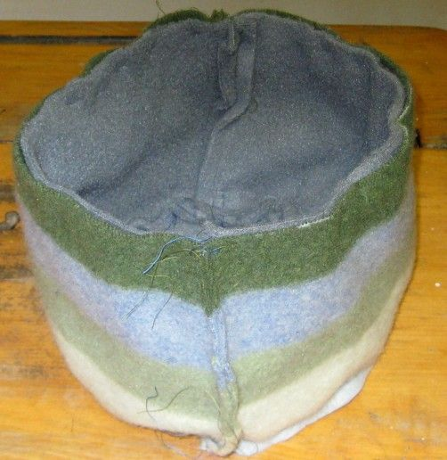 With an old wool sweater and fleece hoodie you can make a warm pill box hat in less than a day. This sweater has several moth holes but is 100% lambswool so it's...
