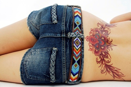 Lower Back leaves & flowers tattoo. Id add some black lace