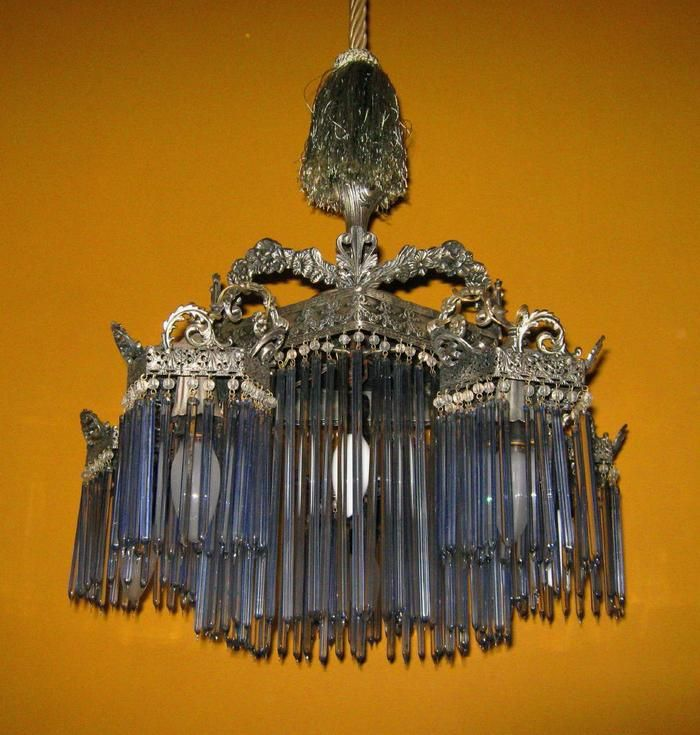 Art Nouveau silvered bronze chandelier with hand blown glass rods