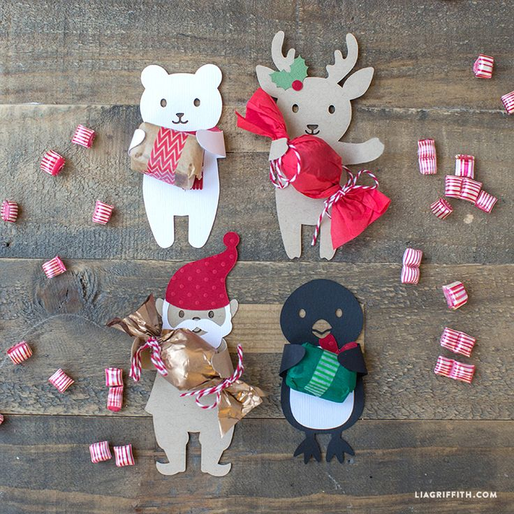 Print and cut your own candy huggers at home, the perfect way to treat the little ones this Holiday season. Printable templates by Lia Griffith.
