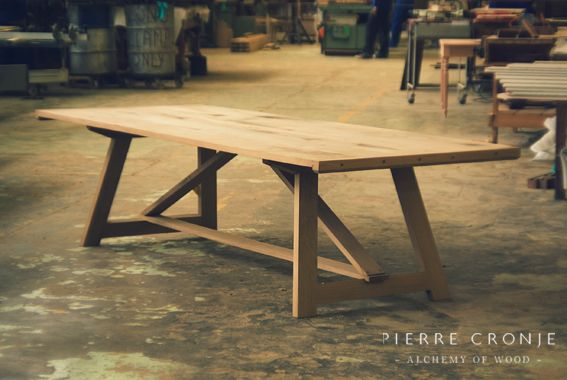 A Pierre Cronje Karoo dining tables shows itself off on the factory floor