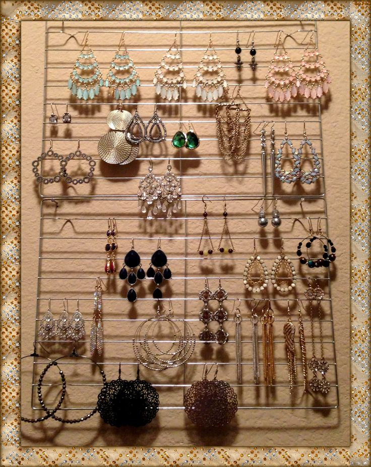 Earring organization with dollar store cooling racks. Need something like this for inside of medicine cabinet doors.