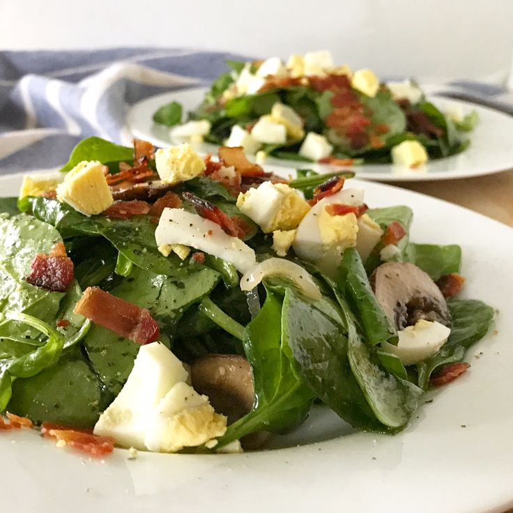 Warm spinach salad with bacon, eggs, shallots, mushrooms and maple vinaigrette. Love this for fall and winter!