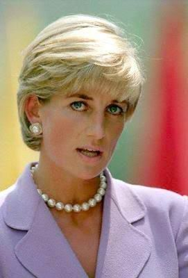 June 17, 1997: Diana, Princess of Wales working with the President of the American Red Cross, Elizabeth Dole in Washington, D.C. in a campaign to ban landmines. U.S.