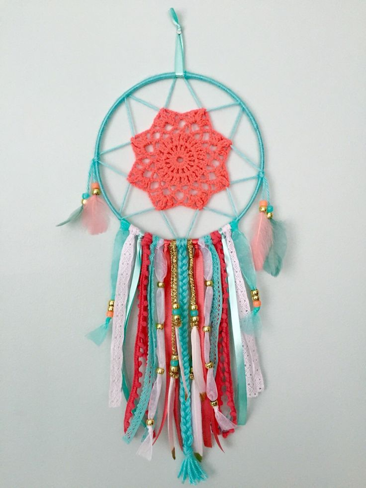 A personal favorite from my Etsy shop https://www.etsy.com/listing/286182217/dream-catcher-coral-aqua-and-gold