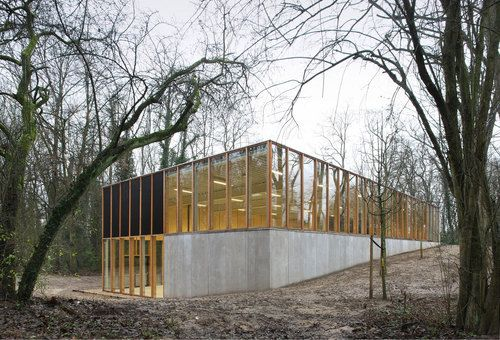 The surrounding forest is the starting point for URA to design a simple building which contains all confrontations of the site : open vs. closed, trees vs. slope, materiality vs. transparency, buil...