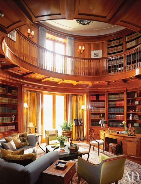 "Isn't this a beautiful home library! It ""makes vague reference to the classical Ionic order,"" Katherine Newman says of the library in a postmodern Toronto house she designed with architectural designer/builder Peter Cebulak. The room's finely carved capitals are complemented by a great number of noteworthy antiques, among them a circa 1790 satinwood worktable."