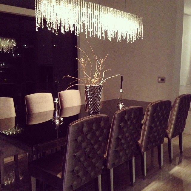 How to create fine interiors with dining room tables for Beautiful dining room chandeliers