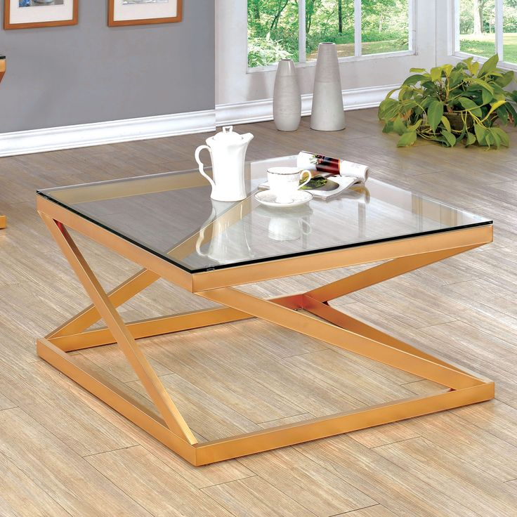 A romantic piece to enhance your living space, this coffee table features a gorgeous metallic gold finish along the metal framework. The clear tempered glass adds a brightening effect that allows the angled legs to shine as the focal point.