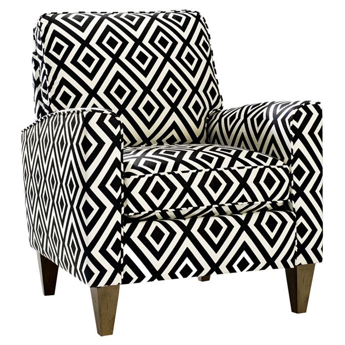 midcentury-inspired arm chair, showcasing a geometric print and square taper legs