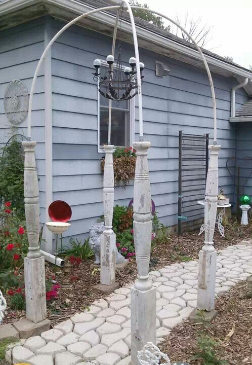Upcycled repurposed porch post garden arch with solar light chandelier. https://m.facebook.com/profile.php?id=108890619189701