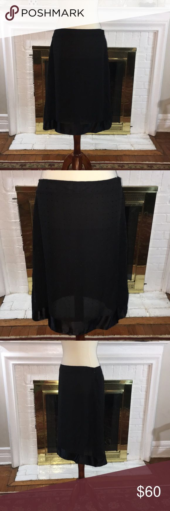 🌹Calvin Klein Silk lined black polka dot skirt 🌹 🌹Calvin Klein silk lined black polka dot skirt Sz 10. Please note all large sizes are pinned to Monique for proper firing 🌹 Calvin Klein Skirts A-Line or Full