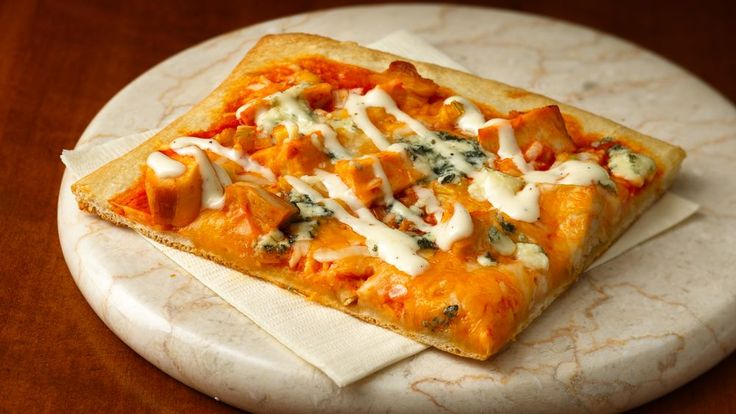 Two of your favorite foods come together in one amazing dinner: Buffalo chicken pizza! All the game day flavors you love are here: spicy Buffalo sauce to bring some heat, with celery, blue cheese and ranch dressing to cool everything down. Cut it into small slices for an easy potluck appetizer, or serve it as-is for a fast dinner no one will be able to resist. (Tip: Choose a mild Buffalo sauce if you'll be serving this to kids or Midwesterners.)
