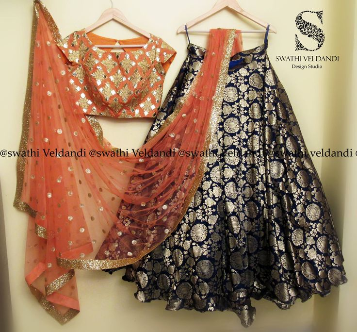 Beautiful navy blue peech banarus lehenga and orange crop top with hand embroidery gold thread work. call / watsapp : 918179668098 for details . 20 October 2017