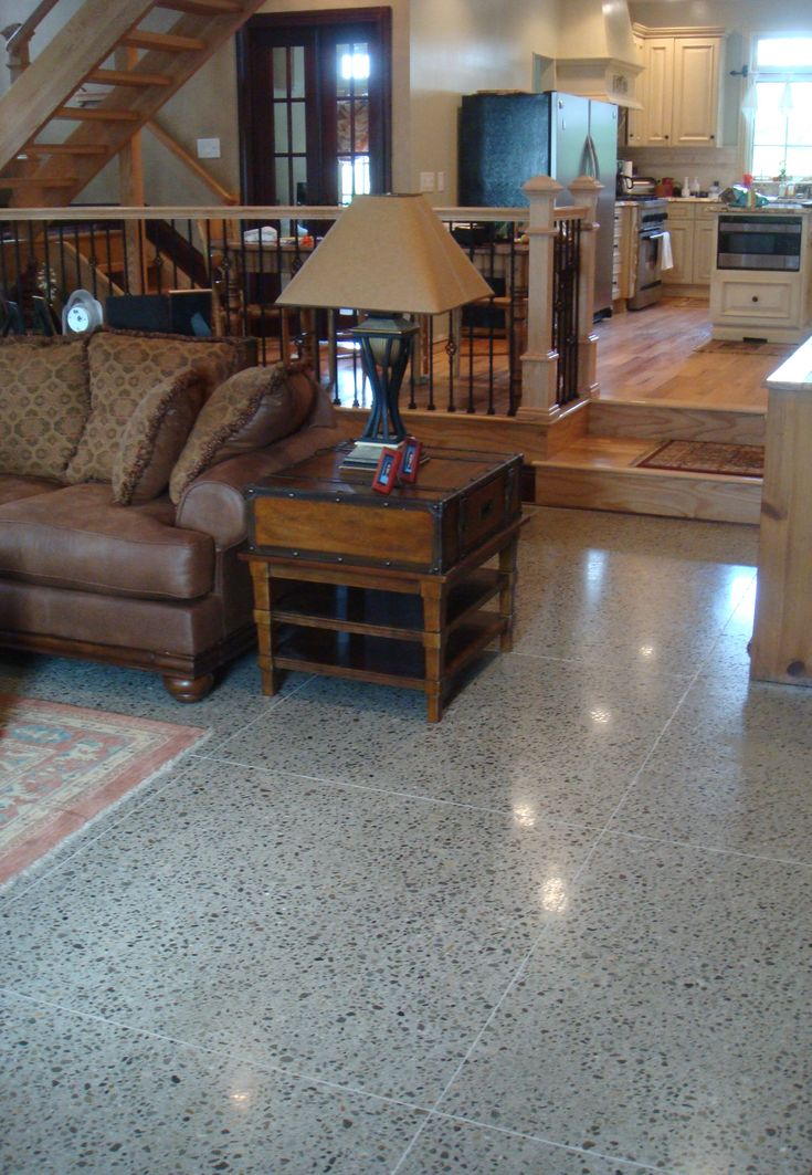 Family room floor with radient heat and tile-patterned sawcuts. The concrete mix design was provided by CI.