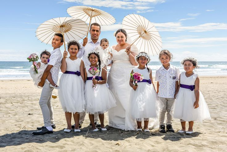 Bride and groom with their 13 children - white dresses and purple belt for the flower girls photographed by Anais Photography