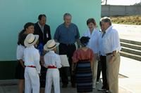George W. Bush (center), Laura Bush, Guatemalan President Oscar Berger (right) and his wife, Wendy Berger, speak with several Guatemalan children and the Principal of the local school while onsite at Santa Cruz Balanya, Guatemala, for a tour of a Medical Readiness Training Exercise on March 12, 2007.