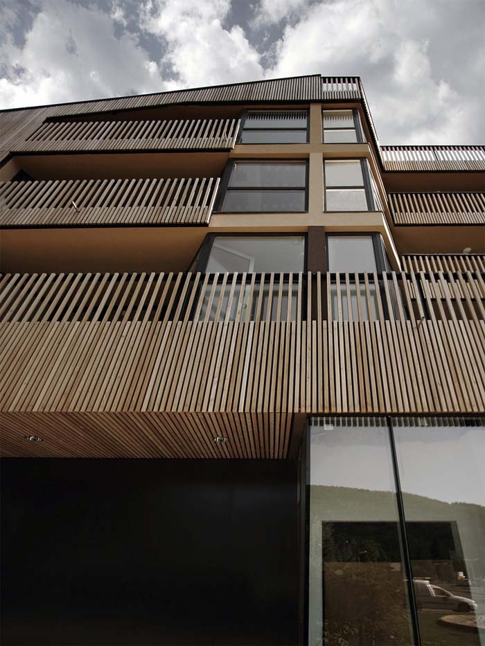 Wooden Facade Shopping Roof Apartments by OFIS arhitekti