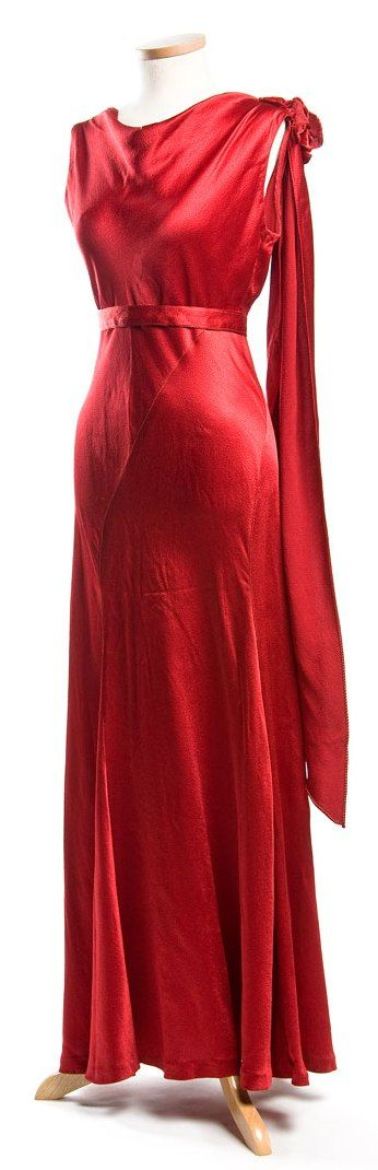 Evening Gown: ca. 1930's, bias-cut rayon, embellished fabric flower, fitted bodice and gored.