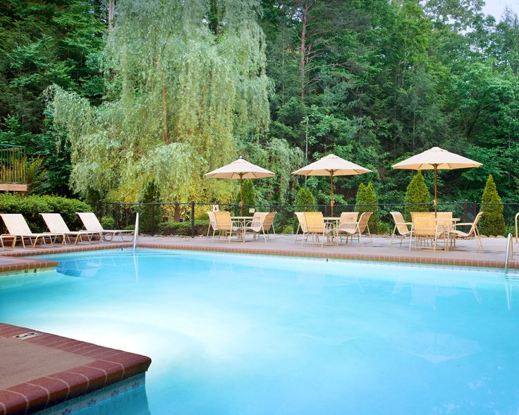 Take a refreshing dip in the outdoor pool on the beautiful grounds of Bluegreen Vacations MountainLoft™, an Ascend Resort in Gatlinburg, TN.