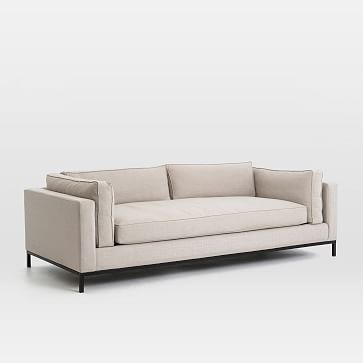 This has metal legs so we would definitely want to do a wood coffee table to bring in that look.     Modern Arm Sofa #westelm