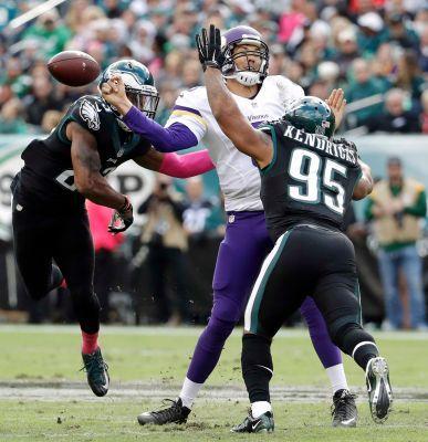 Minnesota Vikings' Sam Bradford, center, fumbles the ball against Philadelphia Eagles' Mychal Kendricks, right, and Rodney McLeod during the first half of an NFL football game, Sunday, Oct. 23, 2016, in Philadelphia.