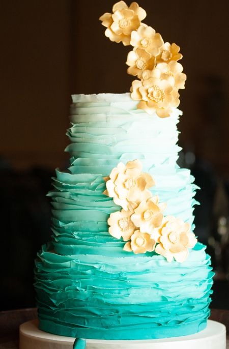 Teal Ombre and Gold Wedding Cake. Pretty, just need to take off the flowers sticking out of the top.