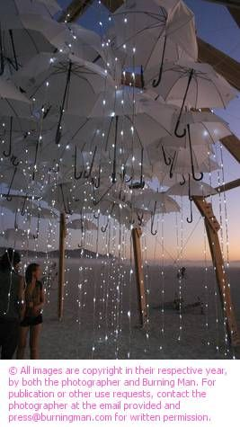 Beautiful Umbrella and Bistro light display!  #love #rainyday #weddingbelle - For more ideas and inspiration like this, check out our website at www.theweddingbelle.net