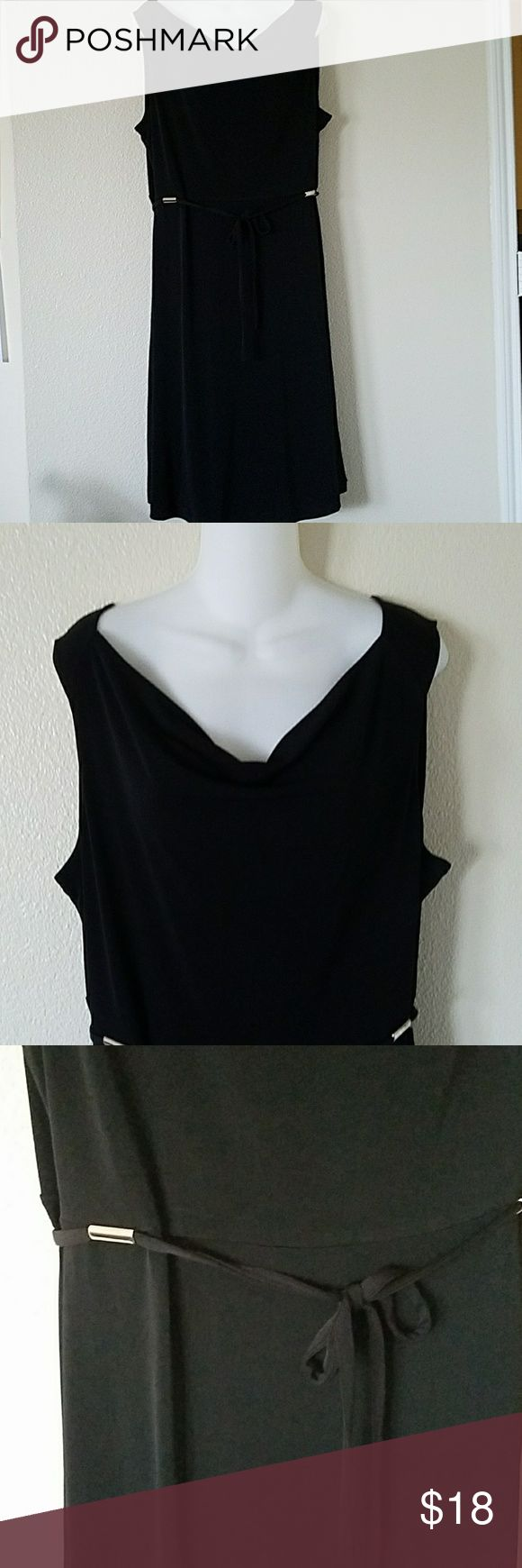 212 Collection black dress size XL 212 Collection beautiful black dress size XL. Necklime drapes a bit, sleeveless, has two silver hardware on waist area, see pic. Easily transition from a work dress to going out little black dress. 212 Collection Dresses
