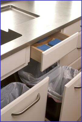 The drawers under the sink hold trash and recycle bins, as well as scrub pads and brushes.  By Richard Landon Design.