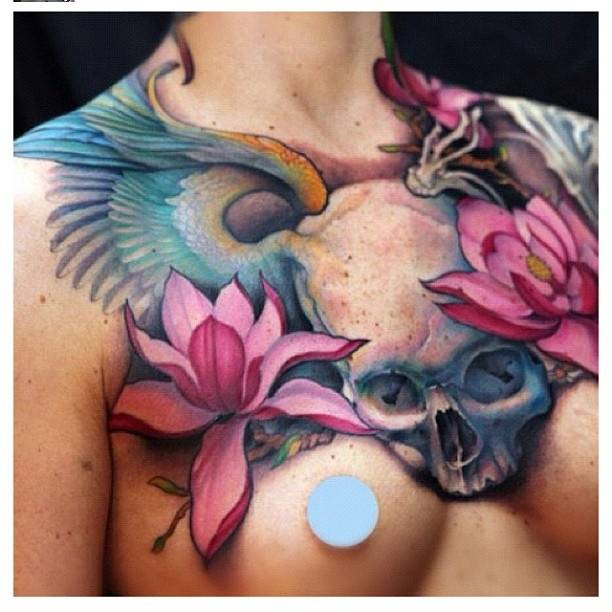 Jeff Gogue. skull, wings, lotus flowers. chest tattoo beautiful colors